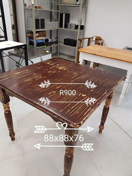 Dark stained wooden kitchen table