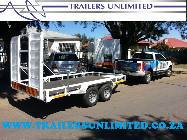 TRAILERS UNLIMITED DOUBLE AXLE CAR TRAILER 5200 X 2100 X 200.