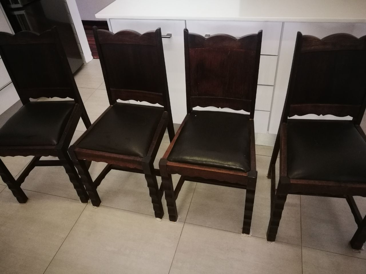 4  solid wooden chairs
