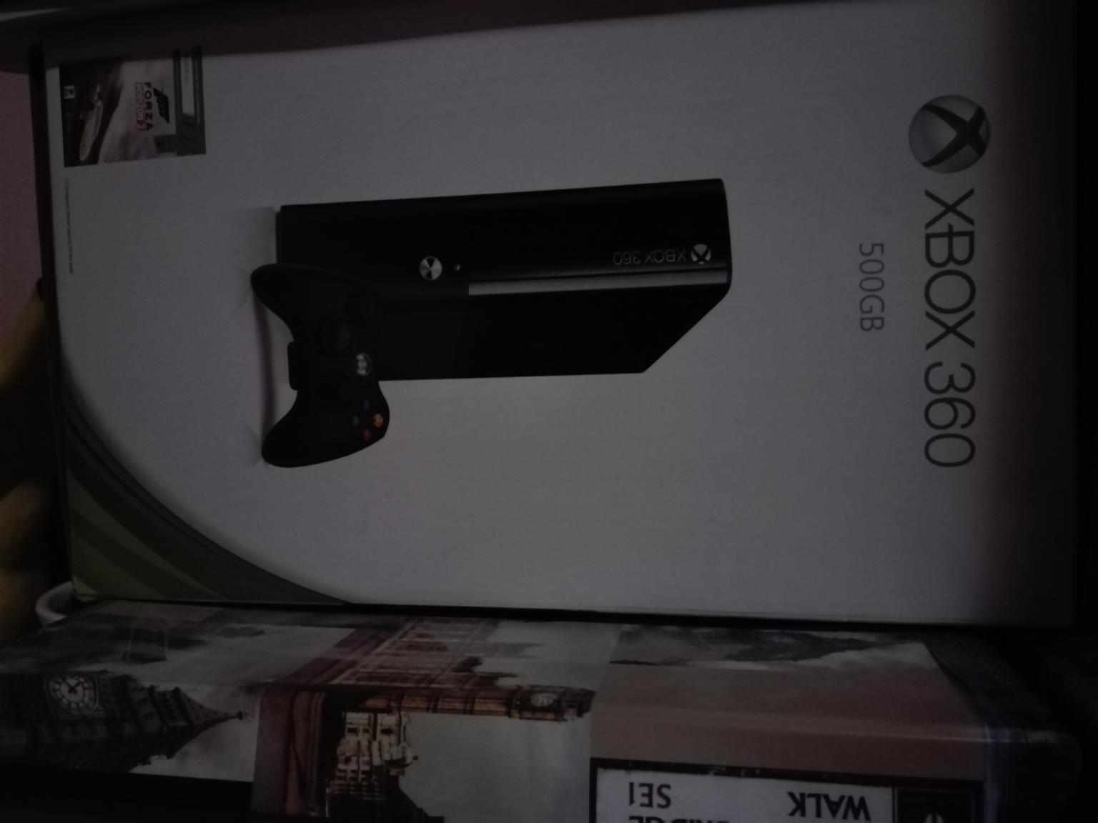 Xbox 360 with monitor and 9 games