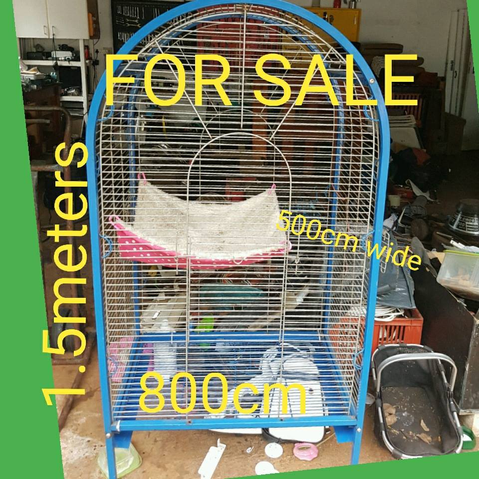 Cage on wheels in good condition for sale