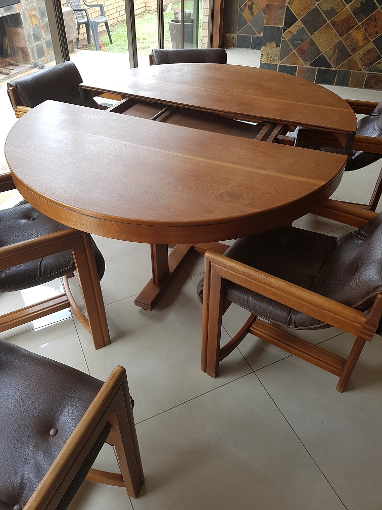 Cherry Wood Expandable Dining Room set early 1970's. 6 leather chairs and server.