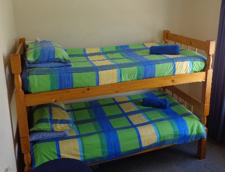 Double bunk bed, single pine beds and bedding