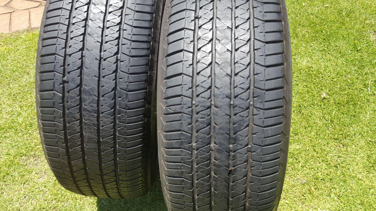 Two 70% tread 265/60/18 Bridgestone Dueler HT 684 tyres