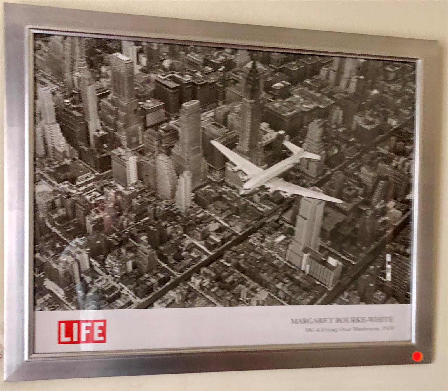 Print with Silver leaf frame under glass of a DC-4 flying over New York City