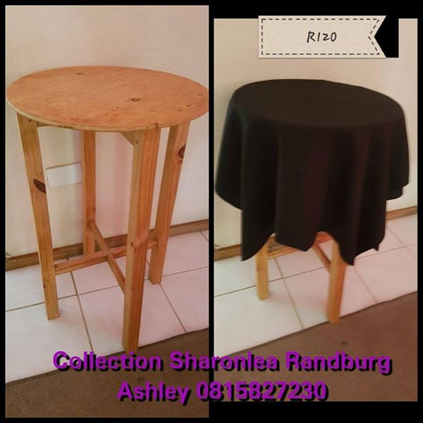 Wooden round table with cloth