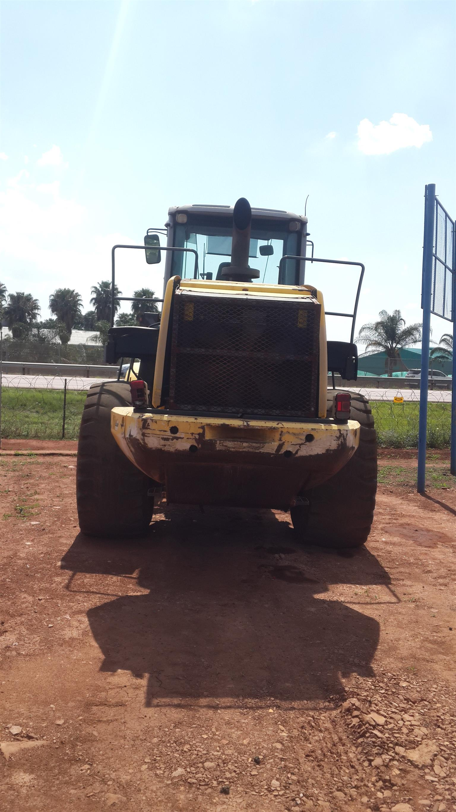 Bell fronted loader L2606E and New Holland fronted loader W270B
