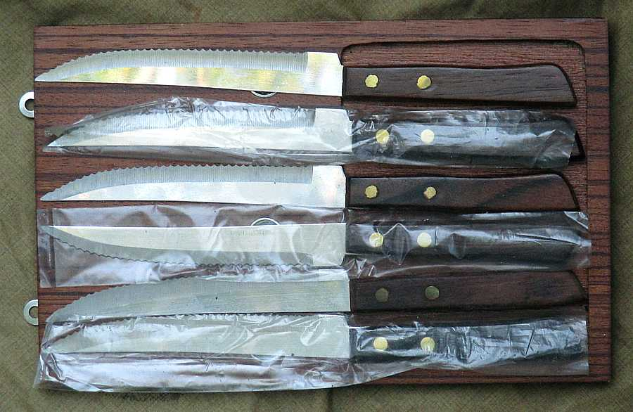Steak knives - set of six, on hanging board, as new