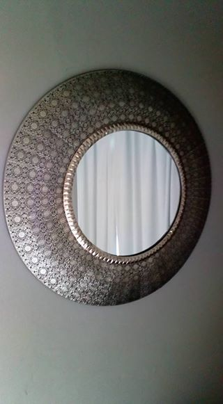 Interesting metal round mirror