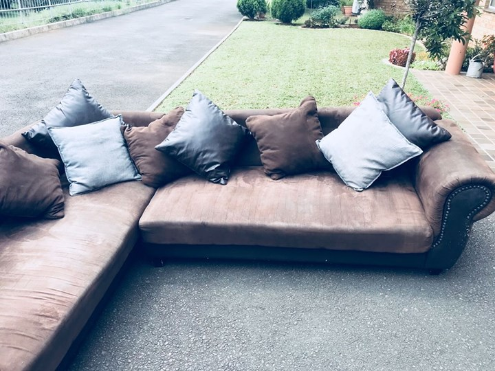 L-shape suede couch with 10 pillows