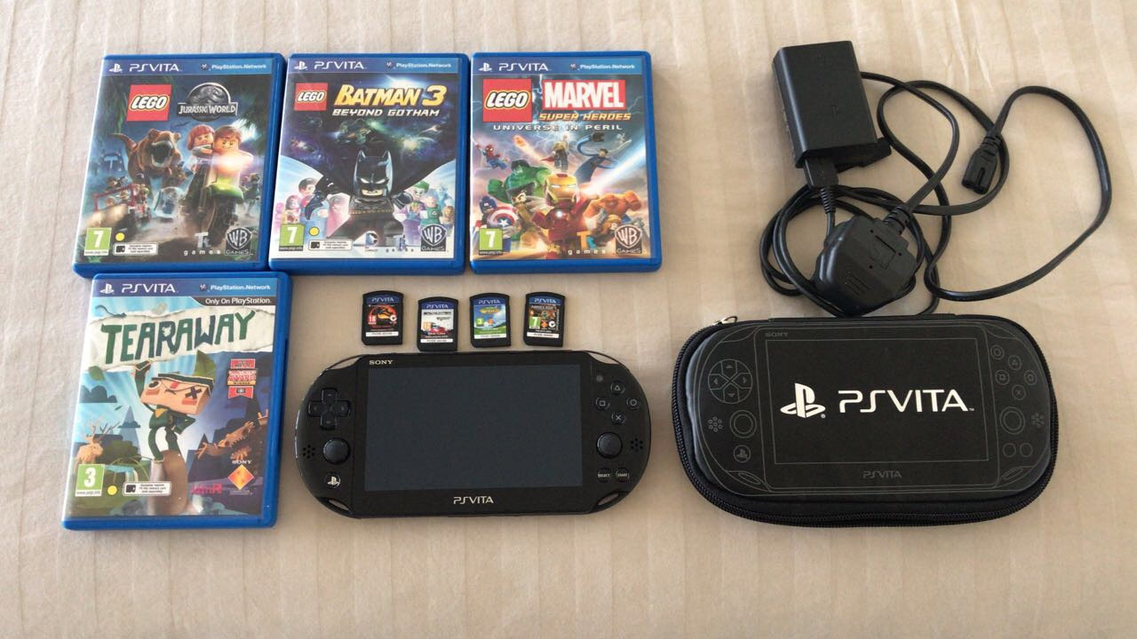 PS Vita with 8 games.