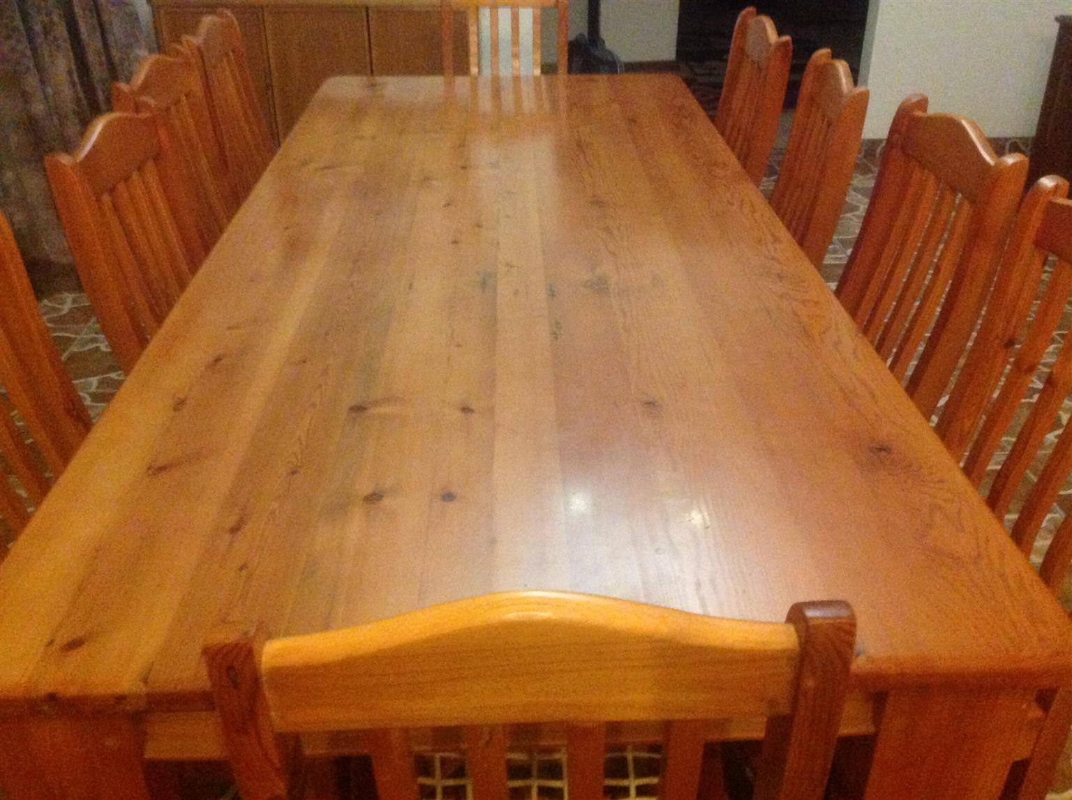 An Oregon Pine Table. With 10 chairs.