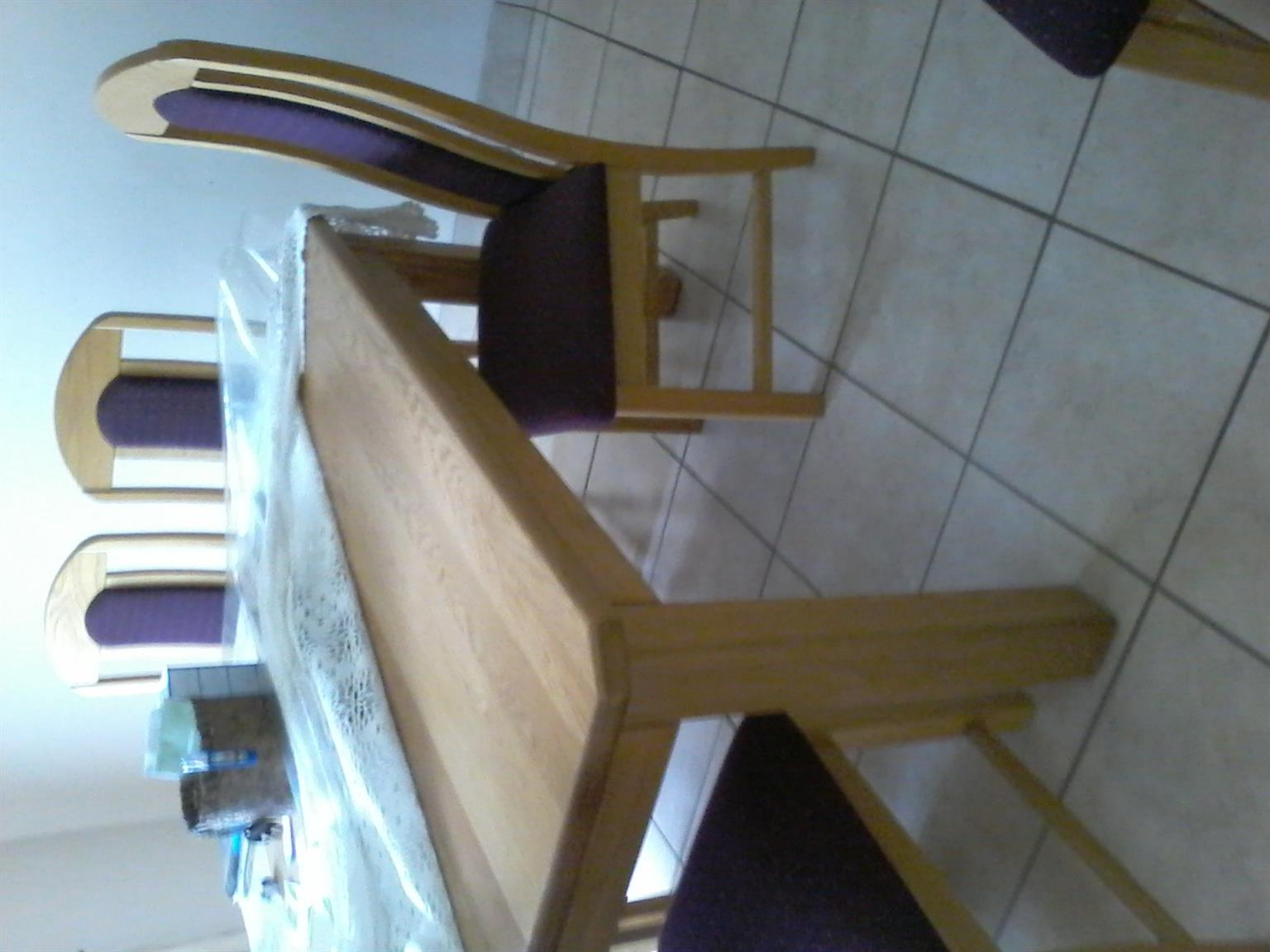 Solid oak table with 8 chairs. As  new