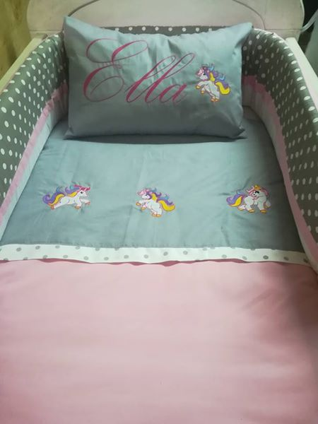 Cot with mattress and bedding