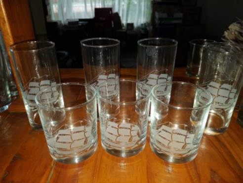 Ship engraved tall and short glasses