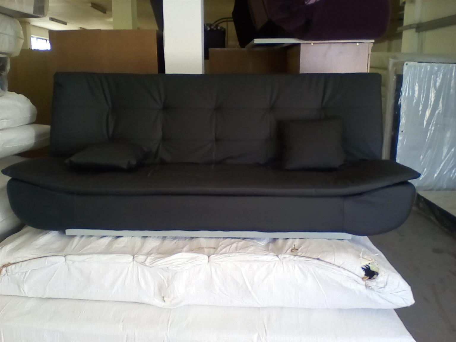 new black sleeper couch