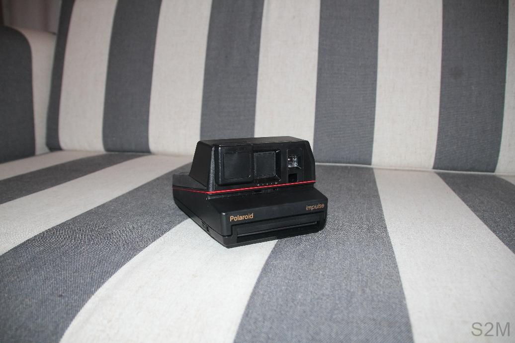 Polaroid Impulse 600 plus instant film camera.