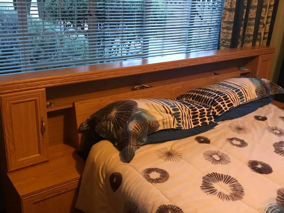 Light wooden double bed headboard