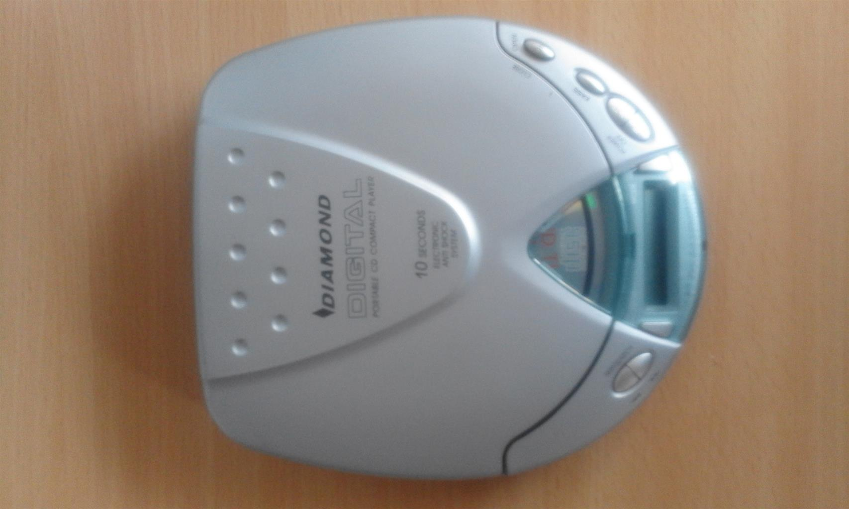 Discman with charger,earphones, battery compartment.