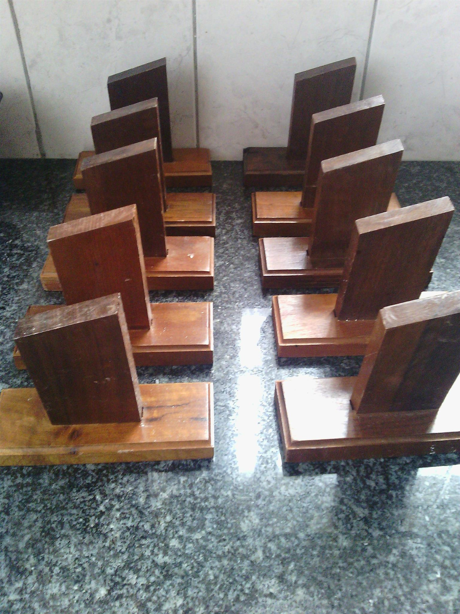 34 Plain wooden trophies