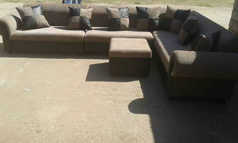 7 Seater couc,h 7 cushions and 1 ottoman