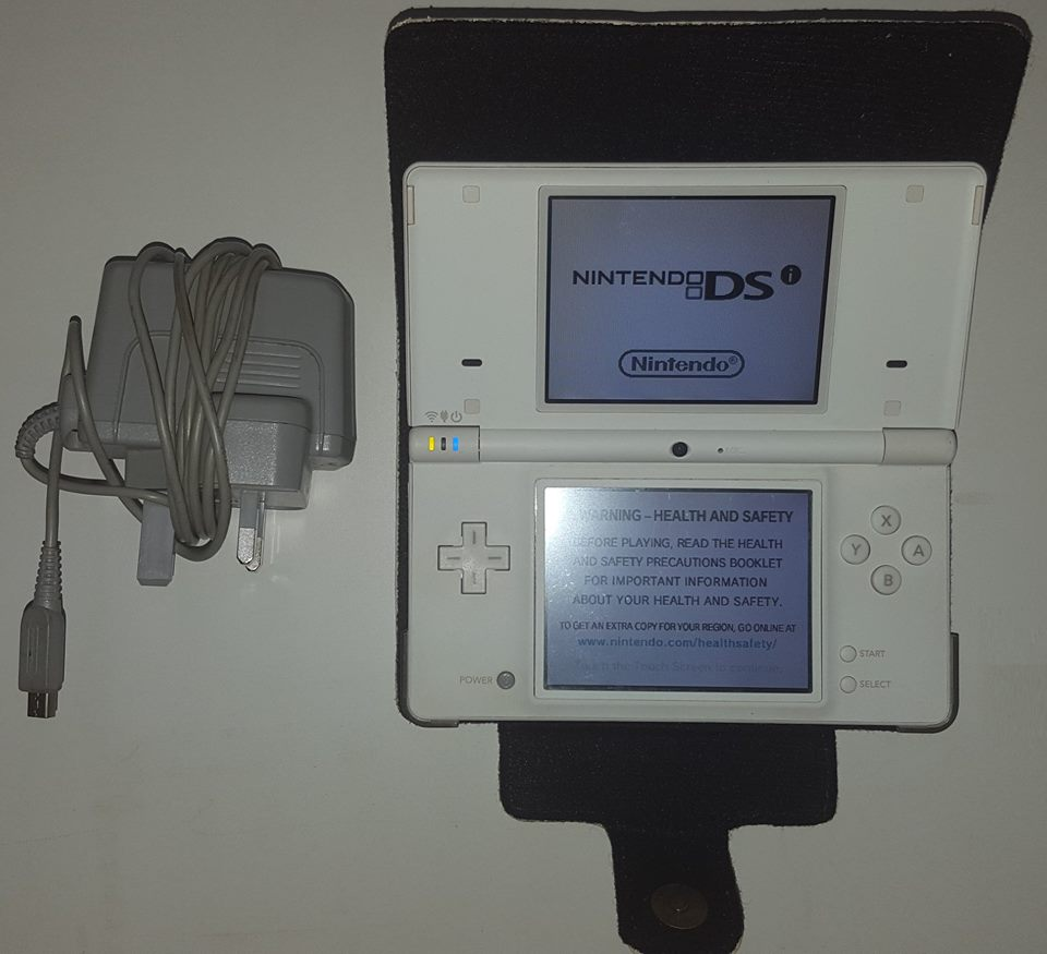 Nintendo DSi with 6 games