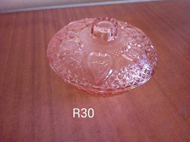 Rose colored glass holder
