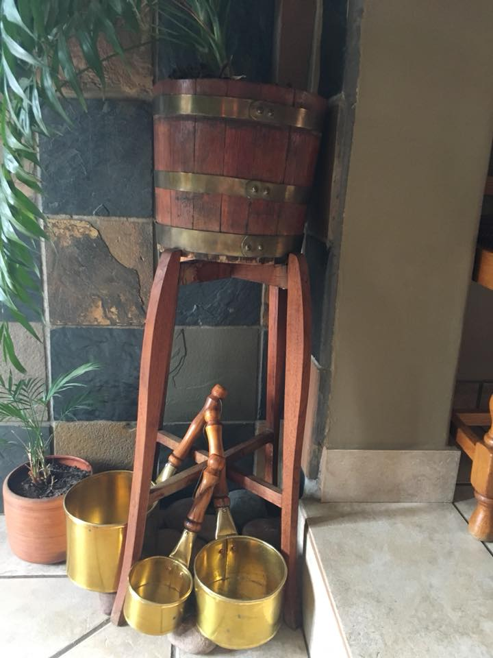 Wine barrel on stand with pots