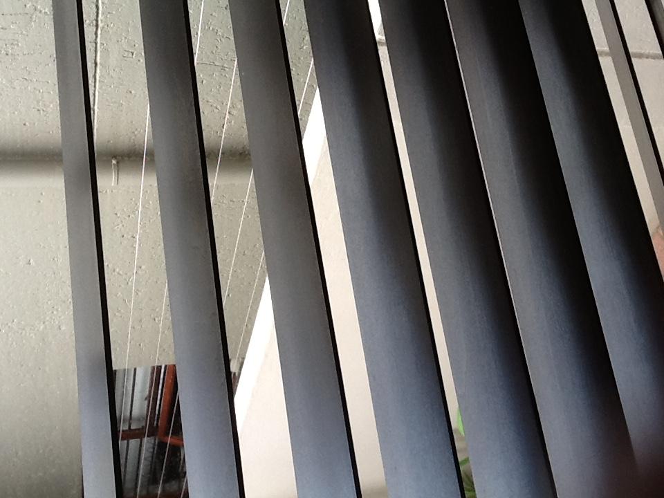 2 dark brown wooden blinds