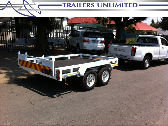 TRAILERS UNLIMITED. CUSTOM FLATBED TRAILERS.