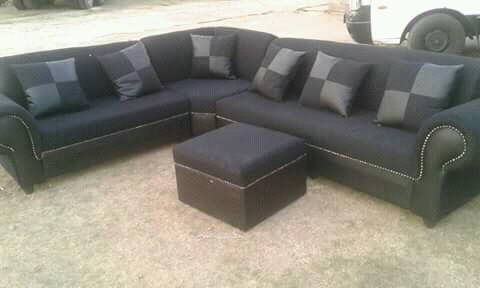 6 Seater couch with 6 cushions and 1 ottoman