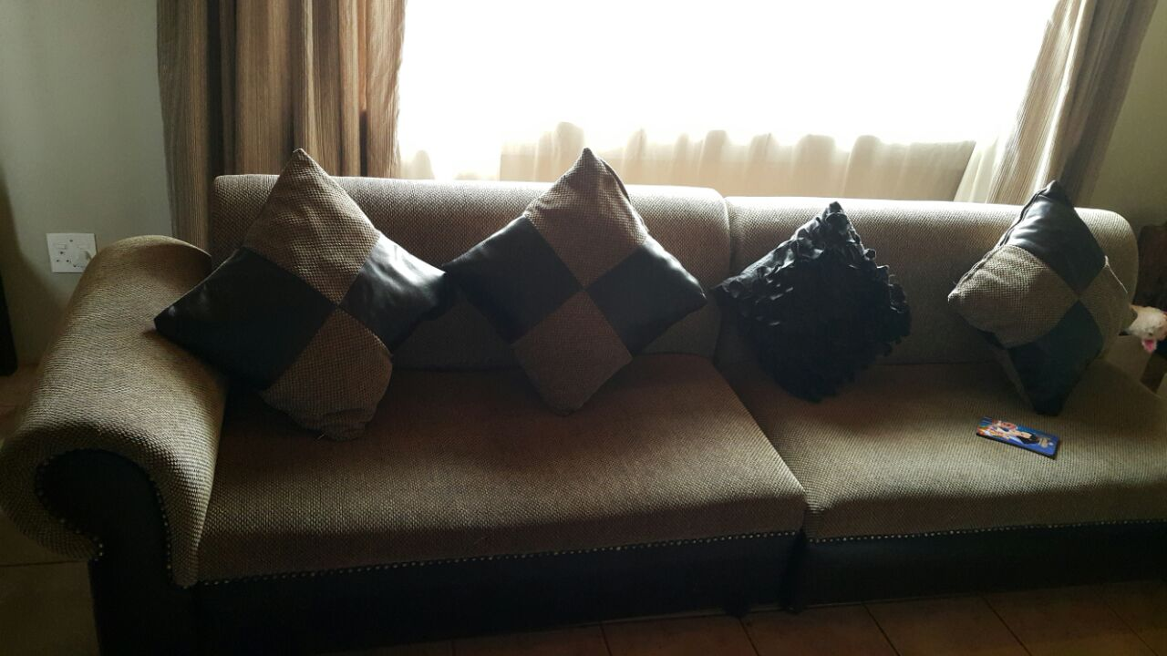 Cream L lounge suite with ottoman cushions good condition, must self collect, price not negotiable  - Delmas farm
