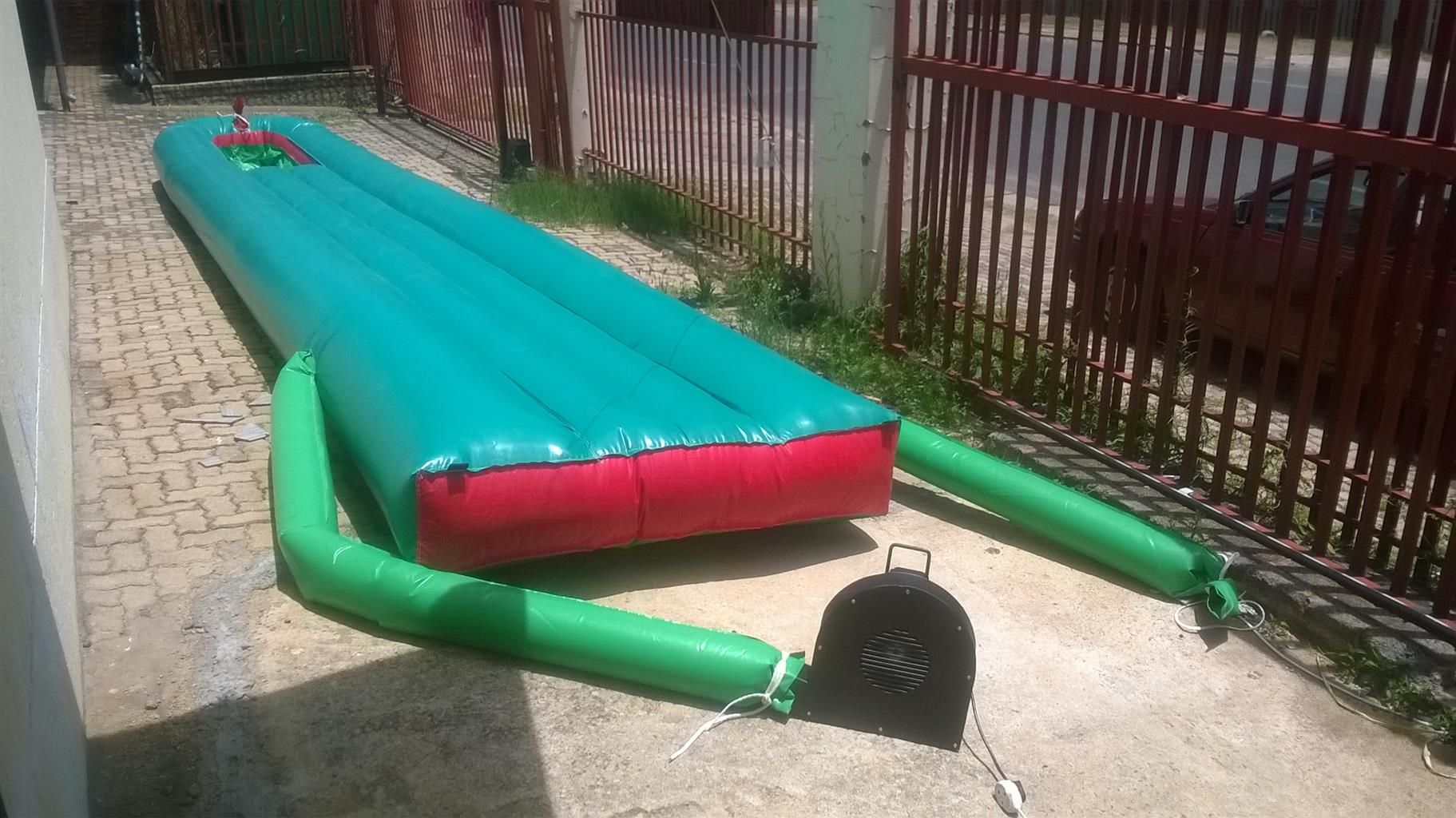 NEW WATER SLIDE 8M WITH BLOWER FOR SALE AT A BARGAIN PRICE.