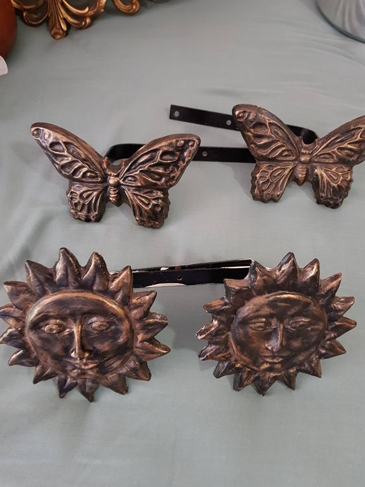 Butterfly and suns wall mounts