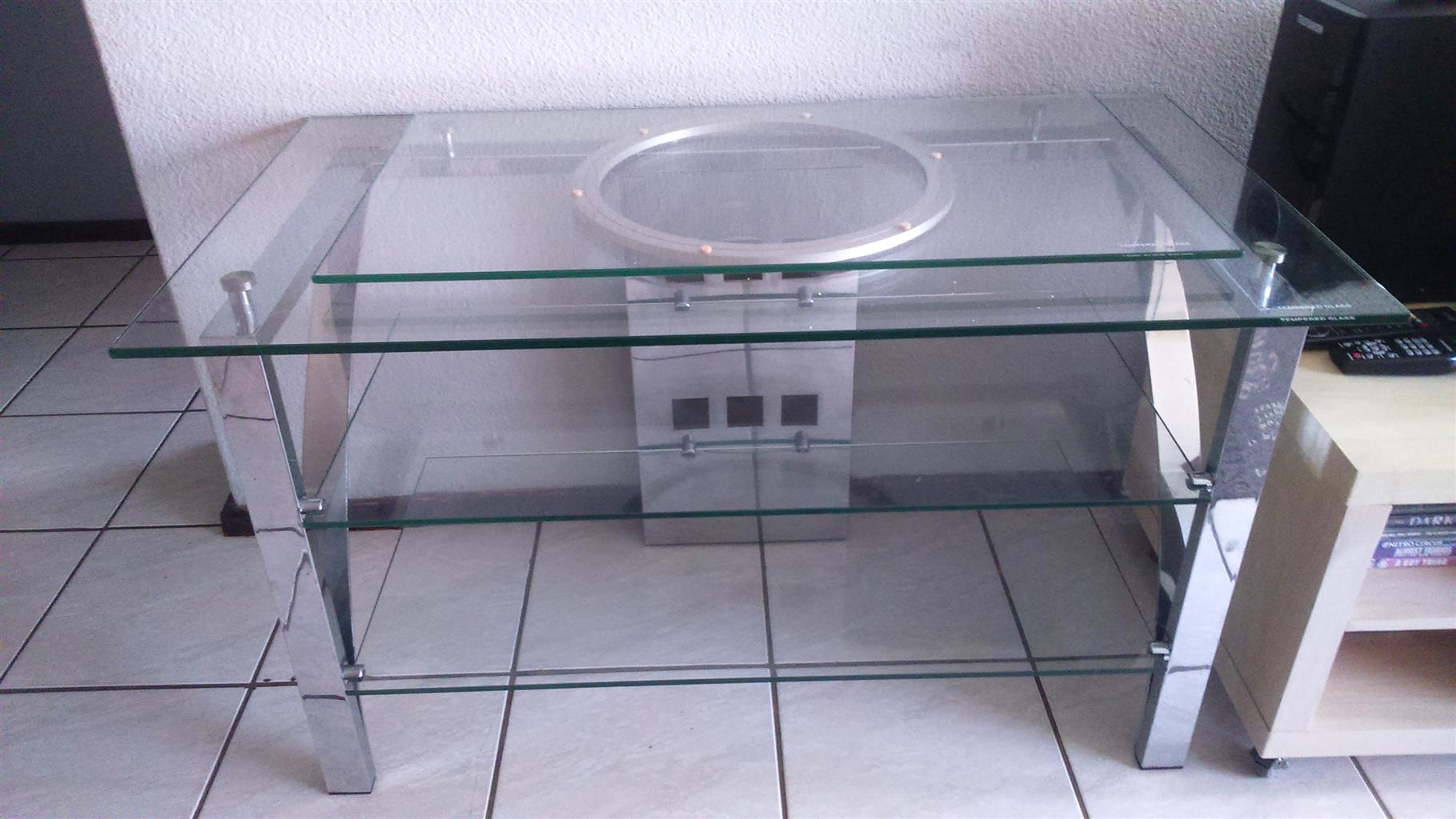 Chrome and glass Tv stand with swivel top tempered glass and chrome frame