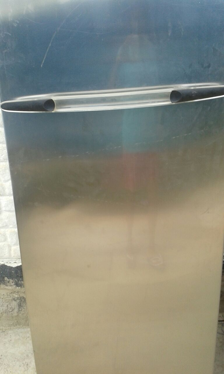 Mettalic whirlpool upright freezer in good working condition R2000 onco