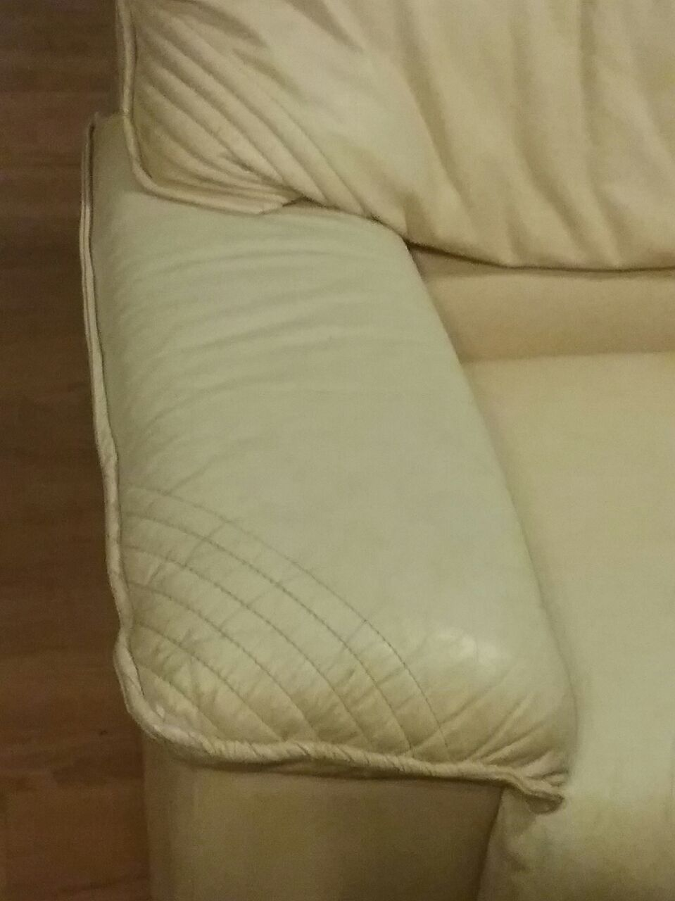 Genuine leather 1 seater couch.