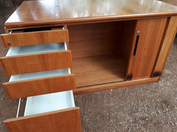 Wooden desk with drawers and sliding door