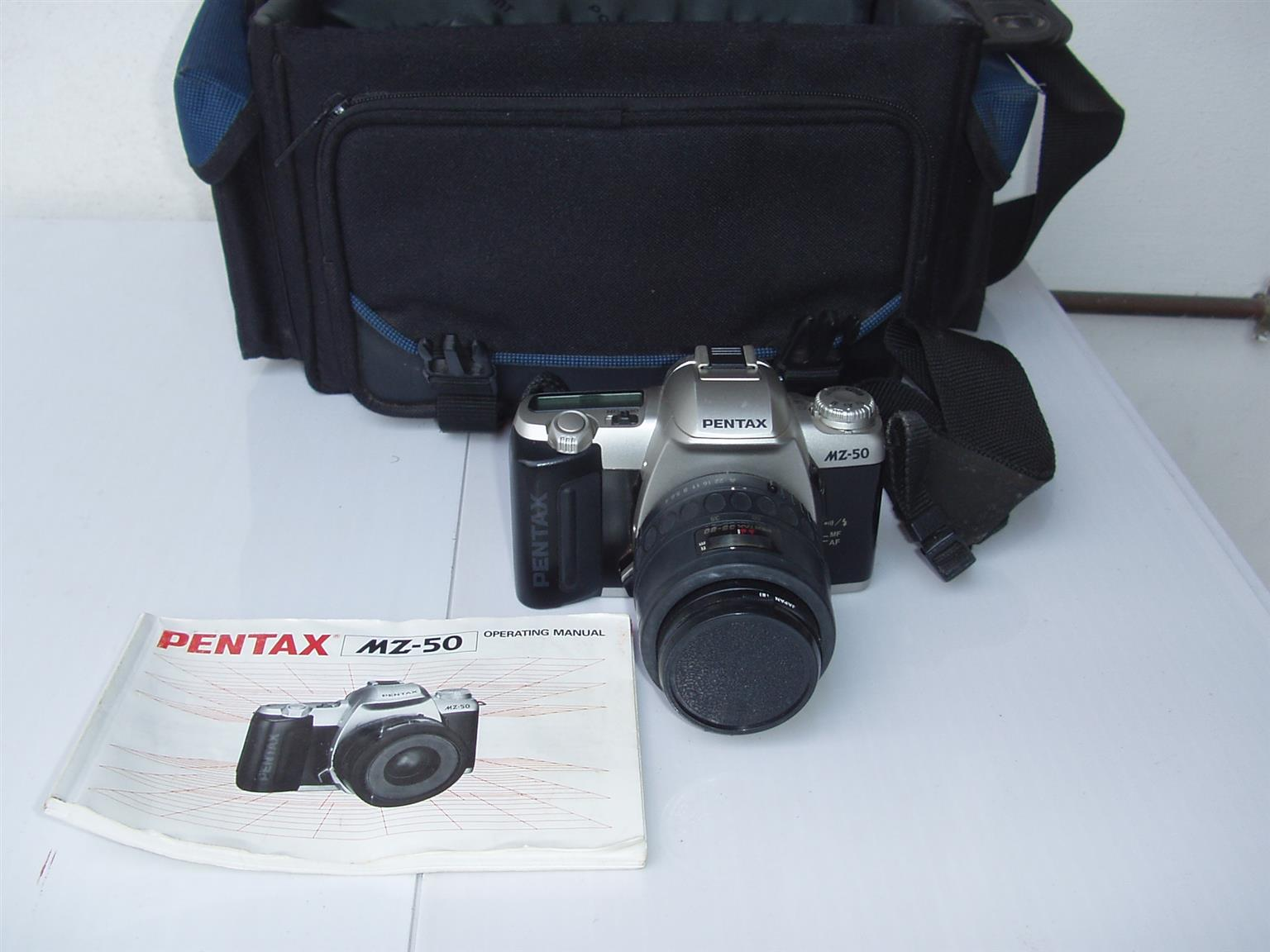 Pentax MZ-50 film camera - complete with zoom lense - manual and camera Bag - R 1750 -as new