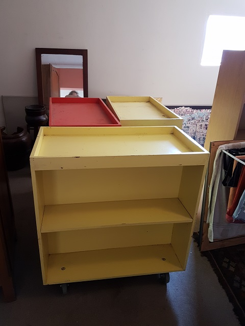 Storage shelves on castor wheels