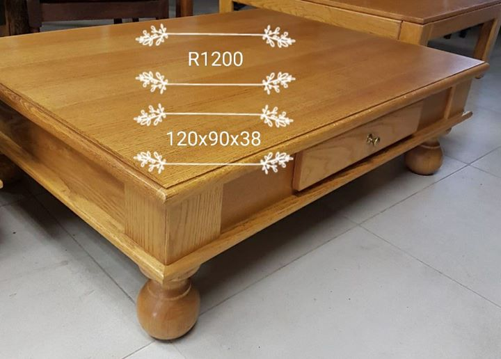 Low wooden coffee table with drawers