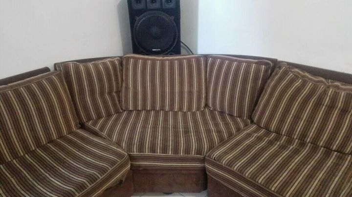 Brown corner lounge suite