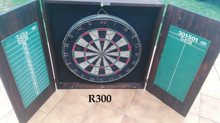 Dartboard in cabinet for sale