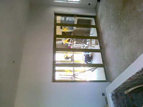 All custom made aluminium windows, doors and balustrades