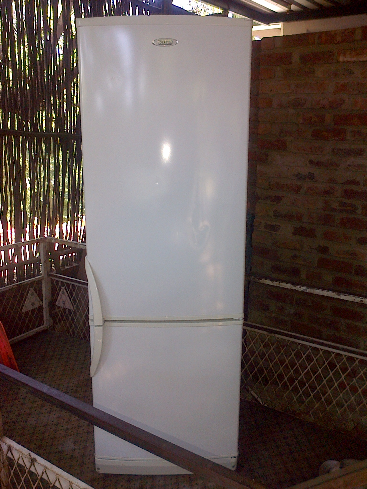 White DEFY 320 liter double door fridge freezer in good condition and working 100% for sale - R1695 cash - I CAN DELIVER