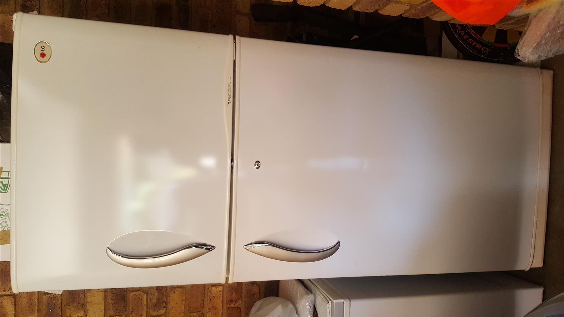 Almost brand new LG white fridge/freezer for sale