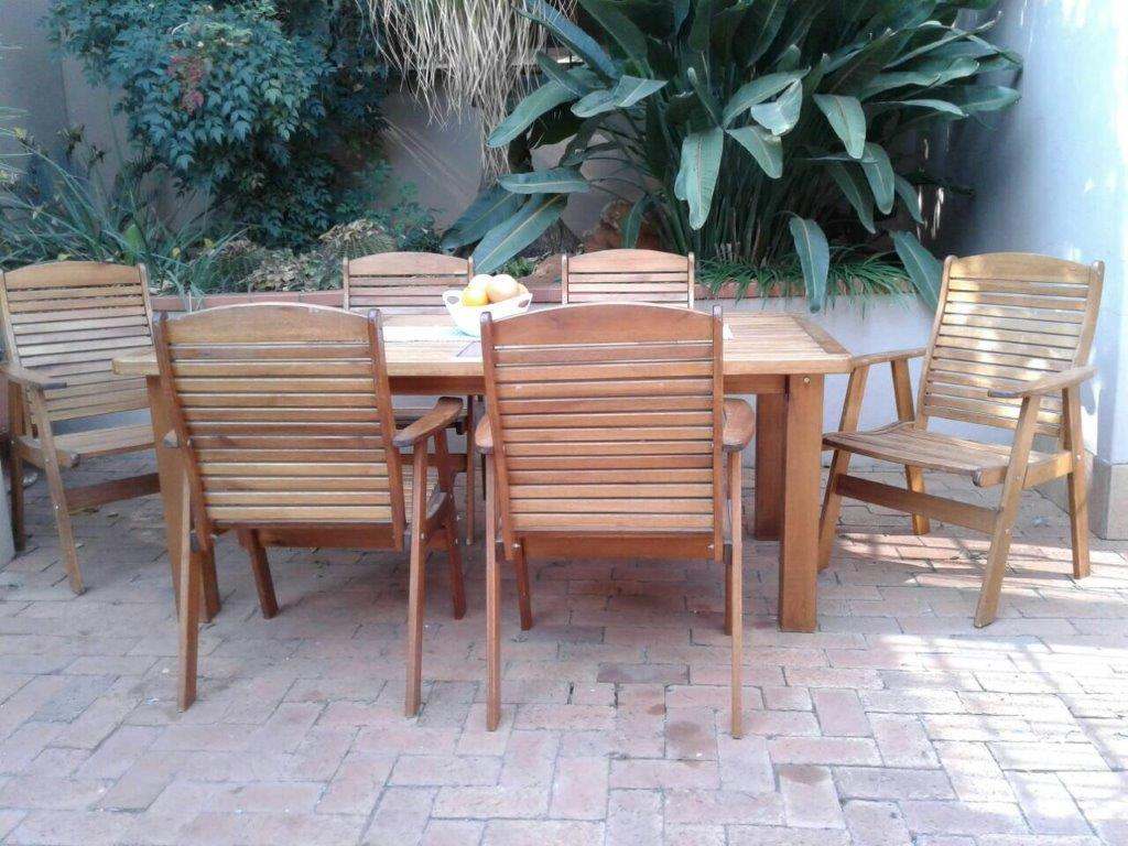 Solid meranti patio table 1 8 x 1 1m with 6 x solid wood fold up chairs top quality junk mail