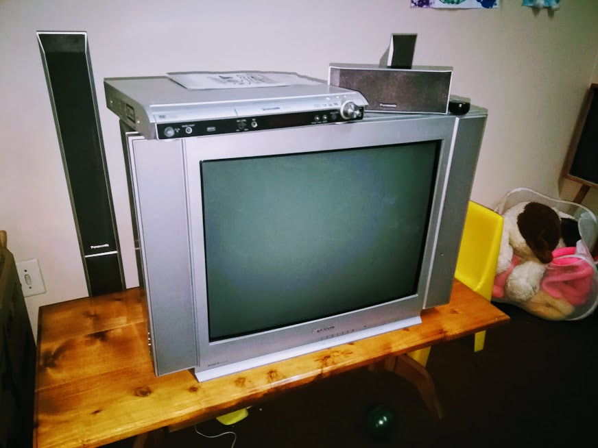 74cm Sansui CRT TV and Panasonic home theater system.